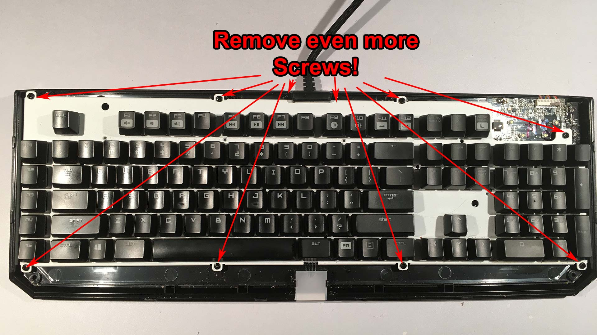 Razer Blackwidow 2014 dissassembly - removing screws for lower housing.