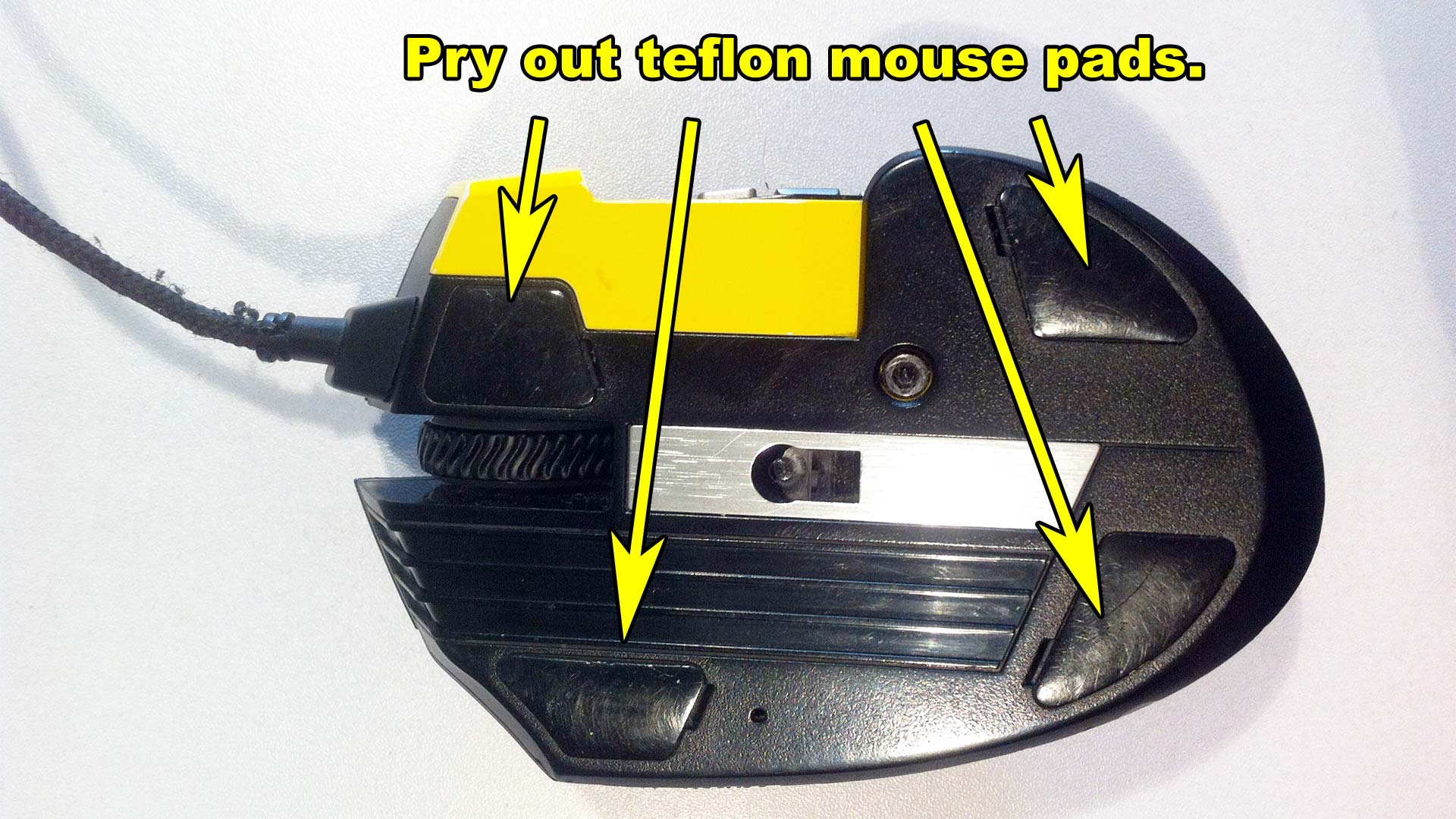Corsair Scimitar Mouse Disassembly - Remove teflon mouse pads.